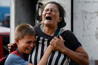 Sixty eight killed in Venezuelan police station riot and fire