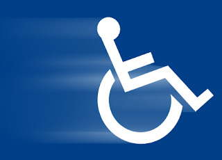 picture of speeding wheelchair on blue background