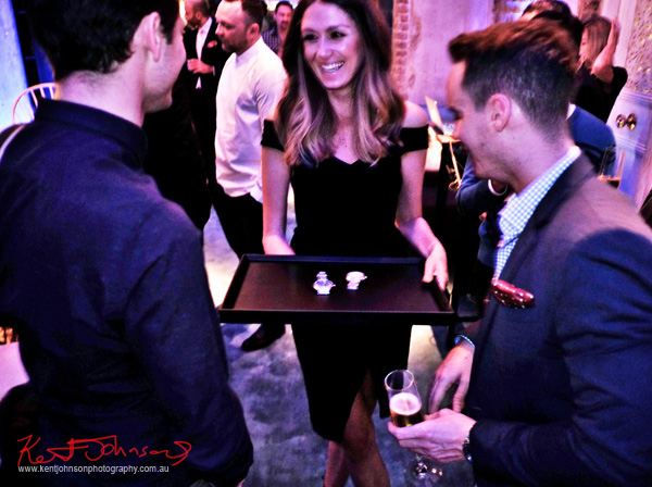 Showing the watches, Piaget Polo S Watch Launch - Beta Bar Sydney - Photographed by Kent Johnson for Street Fashion Sydney.