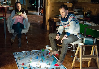 Jonny Lee Miller and Lucy Liu as Sherlock Holmes and Joan Watson in CBS Elementary Episode # 19 Snow Angels