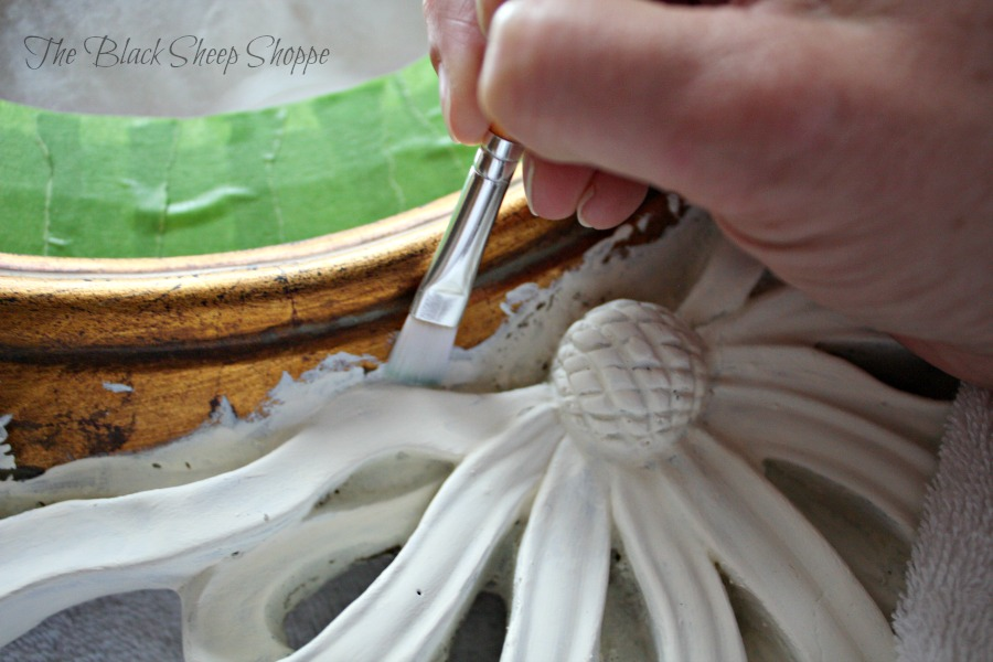 Use a small flat brush to paint decorative trim on furniture.