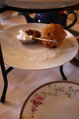 Warm orange blossom scone, clotted cream and preserves.