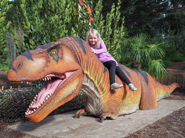 girl riding t-rex