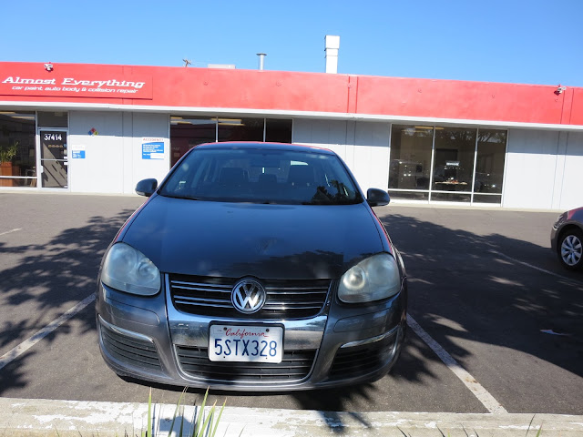 Dent on hood of Volkswagen Jetta before collision repair at Almost Everything Auto Body