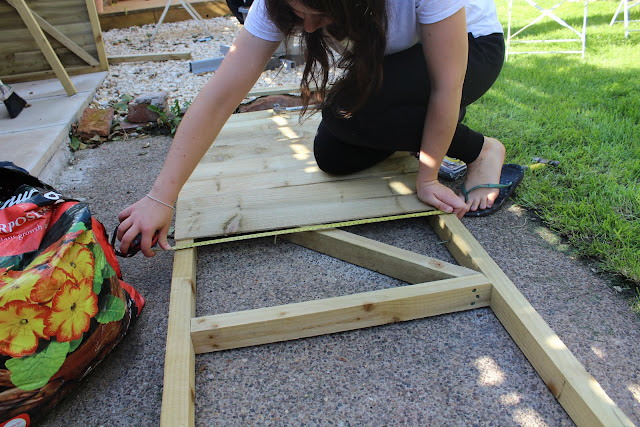 girl making a garden shed