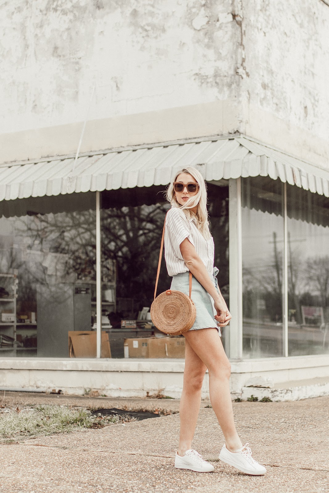 spring outfit with a straw bag