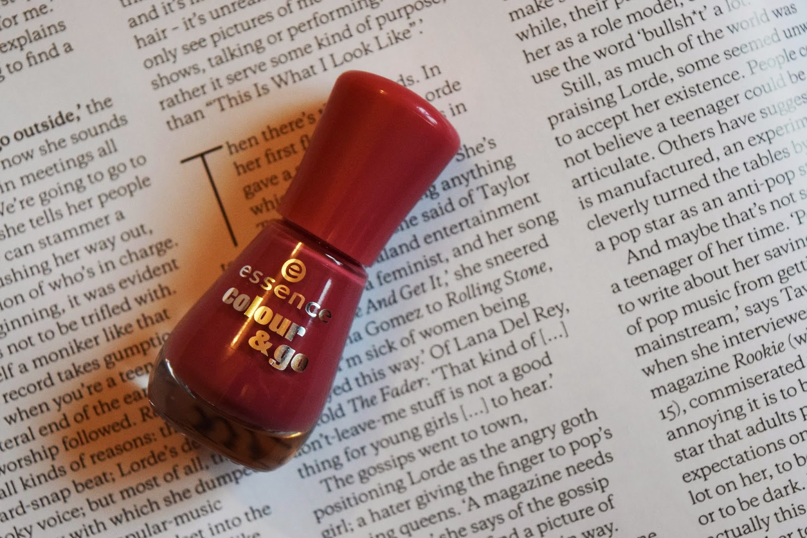 a bottle of deep pink nail varnish