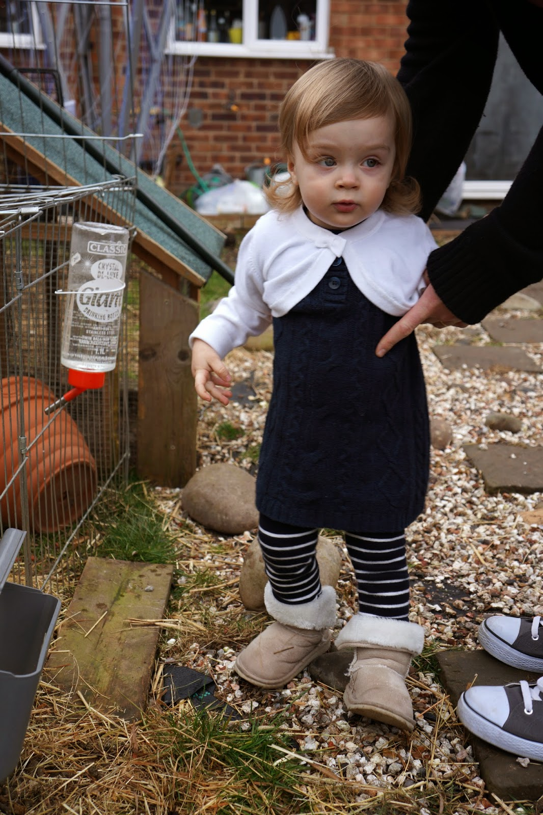 toddler wearing a woolen navy dress