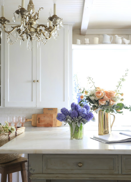 blue hyacinth flowers and garden roses in kitchen with marble
