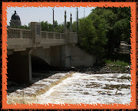 View of Albert Street Bridge and water rushing over the weir, Regina, SK