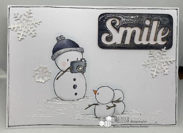 card using snowman taking photos