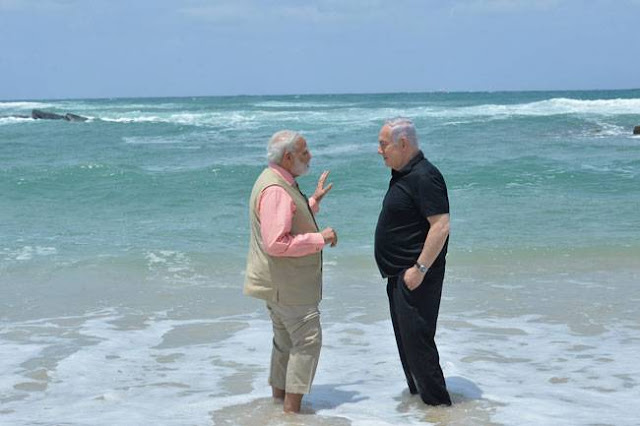 Image Attribute: Indian Prime Minister Narendra Modi with Israeli Prime Minister Benjamin Netanyahu at the Olga Beach in Israel on July 06, 2017. Photo: PIB (India)