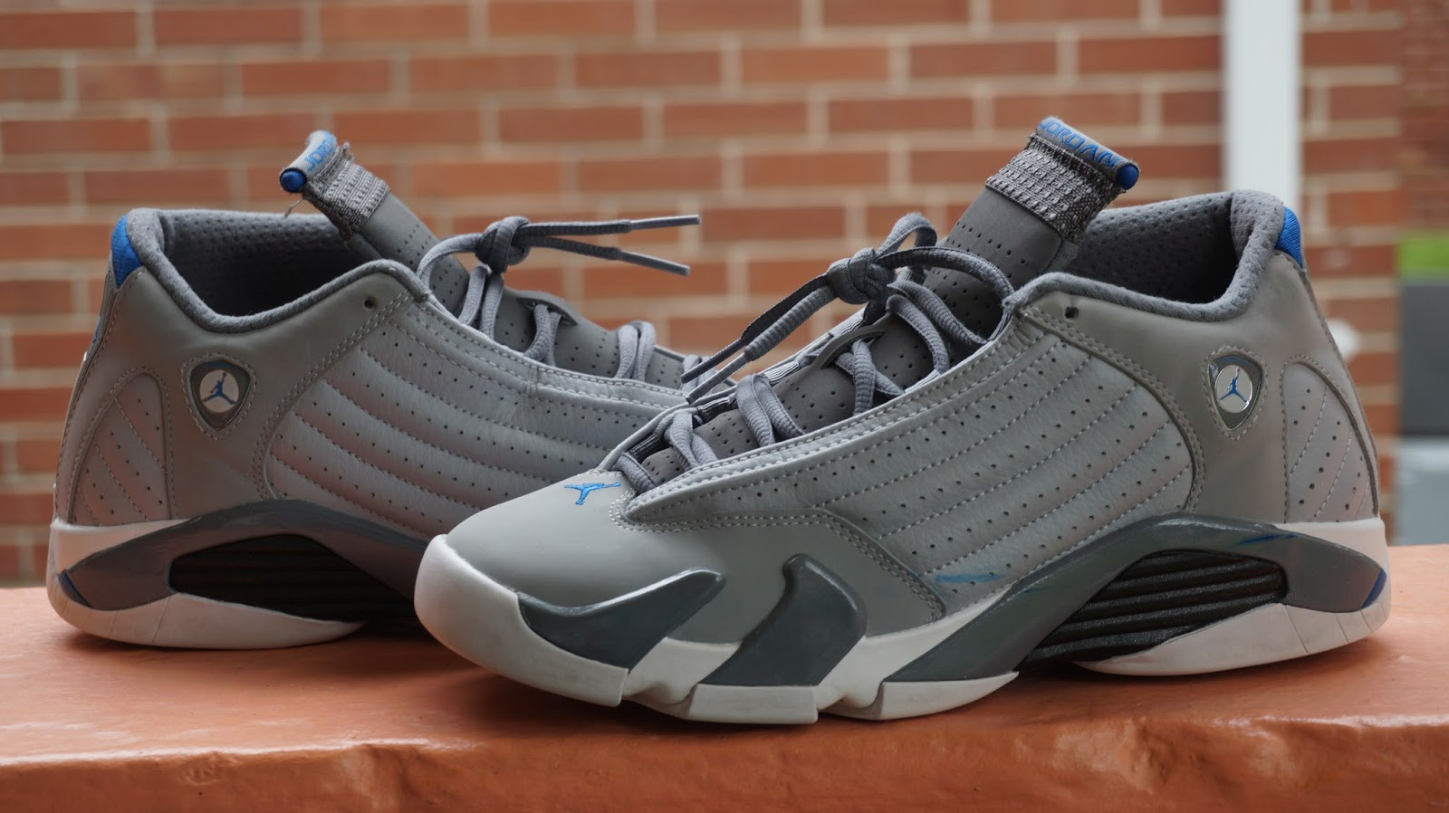 These Jordan 13s Were Found At Platos Closet Are The 13 Wolf Greys This Shoe Is Grey White And Blue In Great Condition