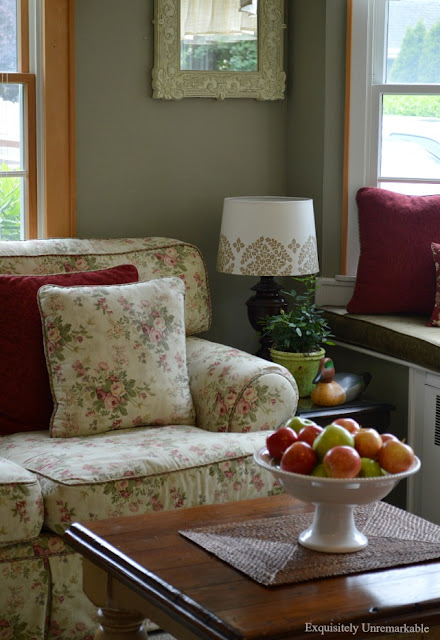 Cottage Style Den with floral couch and small coffee table