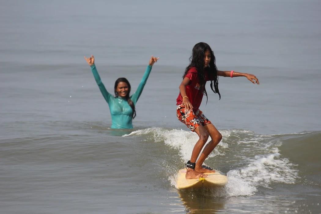 Ishita teaching local girl Tejaswini how to surf