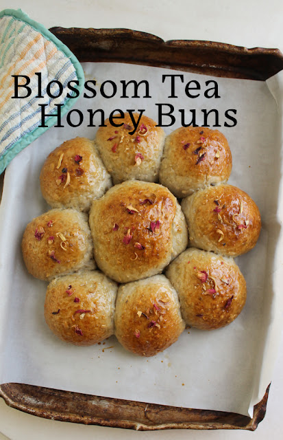 Food Lust People Love: Made with a fragrant tea mix of hibiscus, rose and orange blossoms, paired with ginger and apple, these blossom tea honey buns have a subtle floral note that goes excellently with a hot cup of tea.  For these blossom tea honey buns, I used a Tiesta tea  that my grocery store called Ginger Sweet Peach, despite the complete lack of peaches in the mix. You can use your favorite fruit infusion to make these buns.