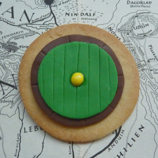 Round green door Hobbit themed cookies biscuit on Lord of the Rings map paper