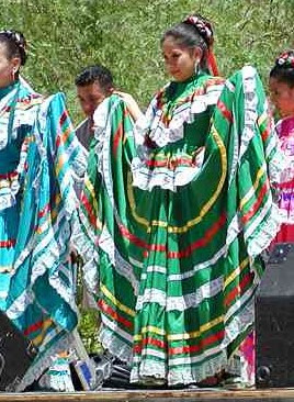 Young girl in cultural costume dancing.
