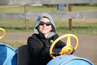 boy driving a blue cart