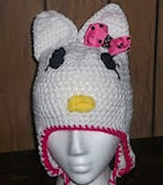 http://www.ravelry.com/patterns/library/little-white-kitty-earflap-hat