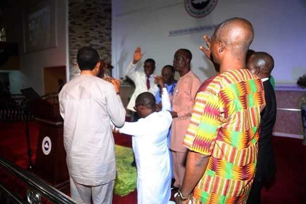 Photos of Governor Okowa on his knees as pastors prays for him