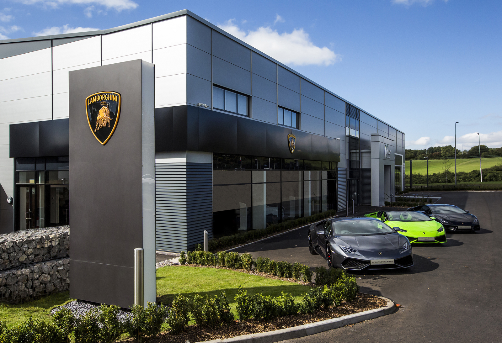 Lamborghini 39 s fresh showroom design ready for urus launch for Car showroom exterior design