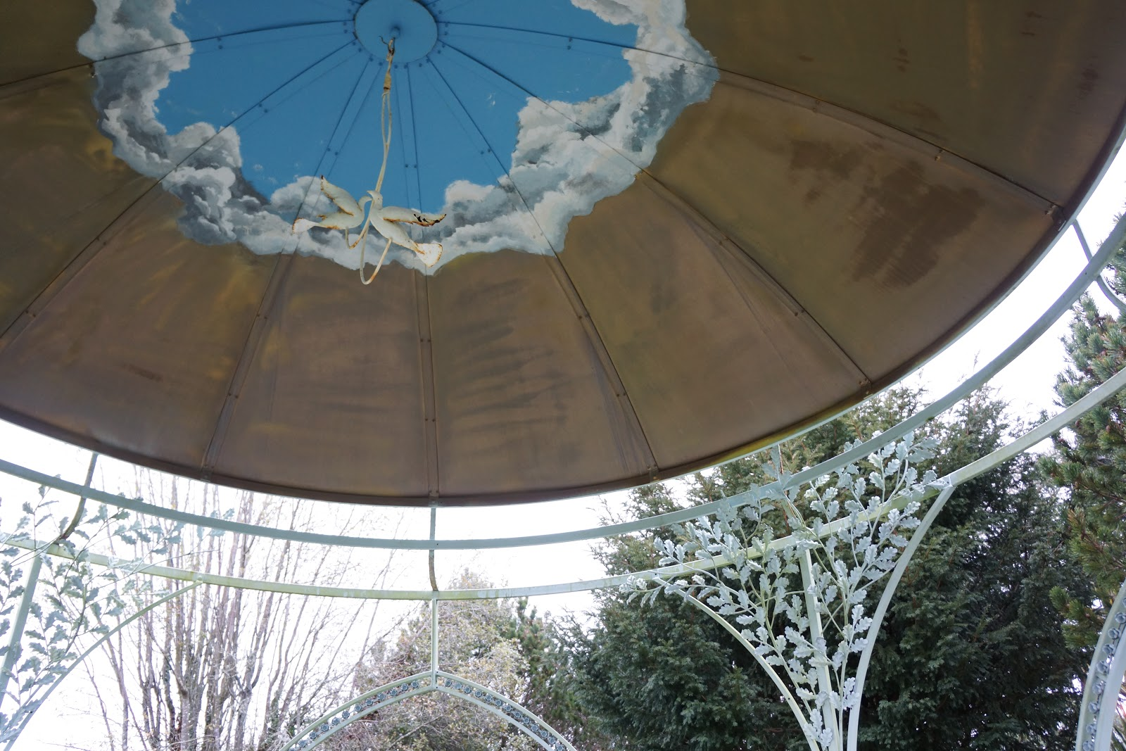 sky and dove painted inside wedding pavillion roof
