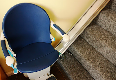 Picture of stair lift at bottom of stairs