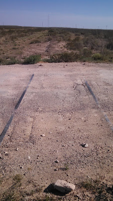The old railroad tracks for the abandoned Pecos River Railway.