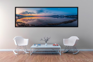 Photograph of Cramer Imaging's fine art photograph 'Blue and Gold' on the wall of a room with a decorated table and two chairs