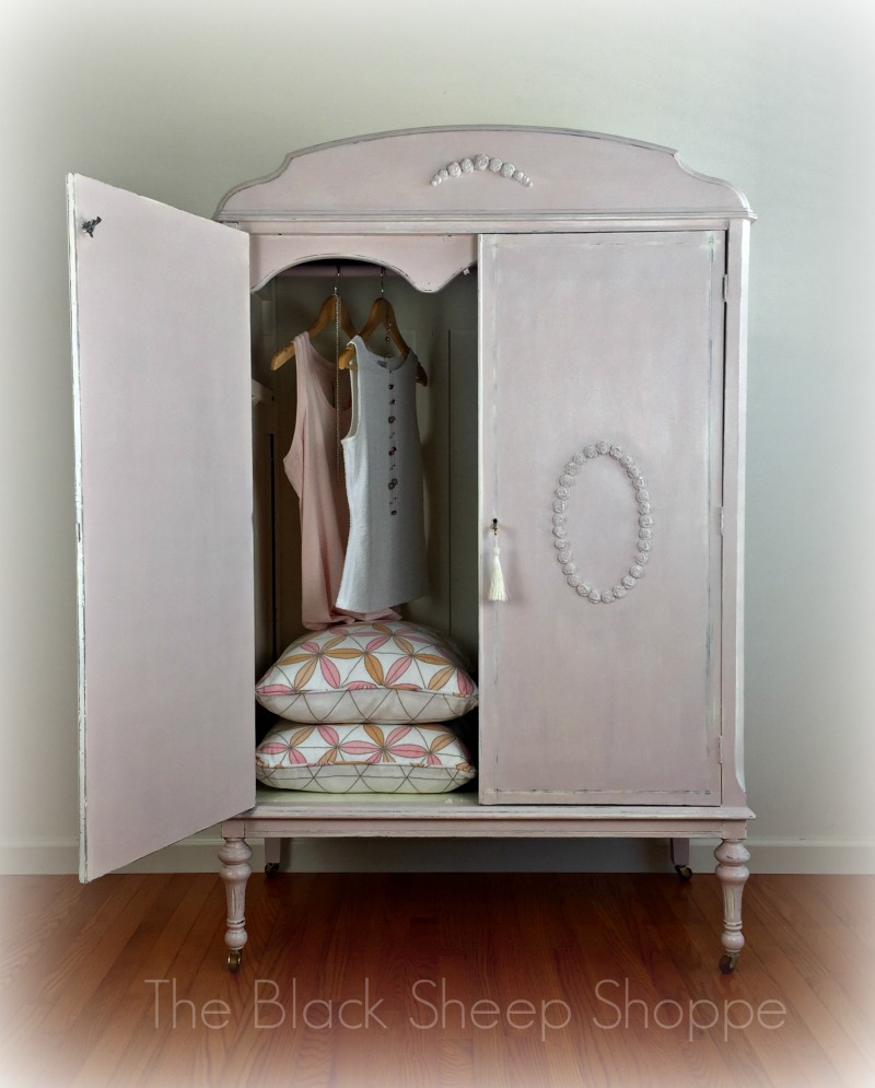 The interior of the armoire was painted in Old White.