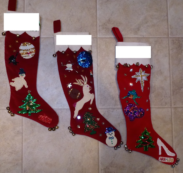 Velveteen Christmas stockings with beads, sequins, bells and Space events.