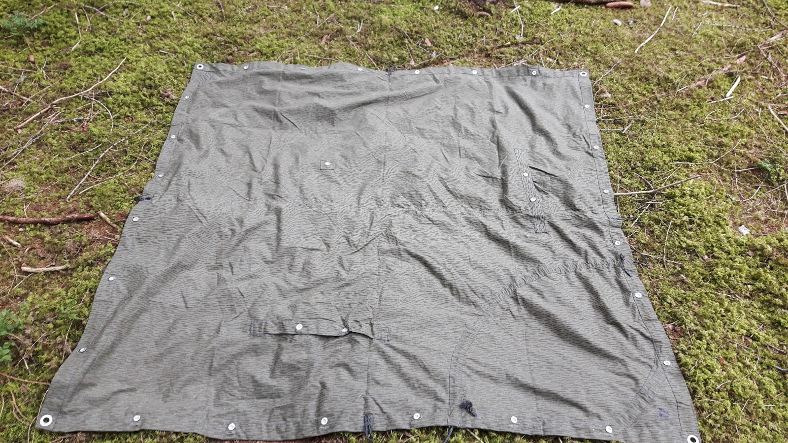 The NVA-Zeltbahn in all itu0027s glory. You can see the four grommets at the corners the metal buttons all round and the arm slits to wear it as a poncho. & Survival Skills and Thoughts on Outdoor Gear and Knives: NVA ...