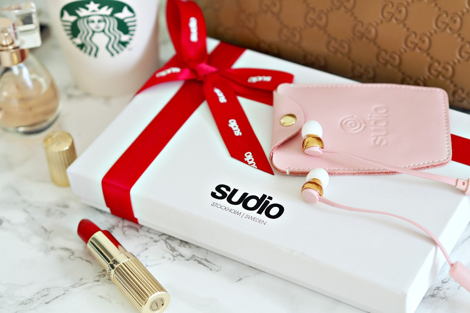 Sudio wireless headphones in pink, perfect for commuting