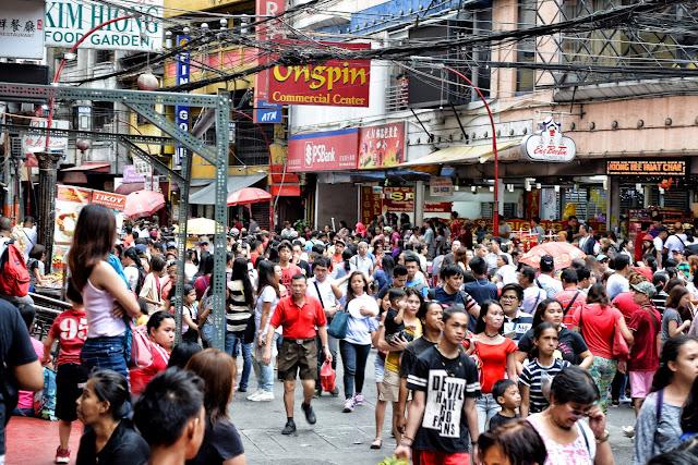 Revelers along Ongpin Street