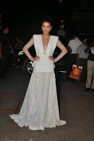 Surveen Chawla In White Dress Pos6.jpg