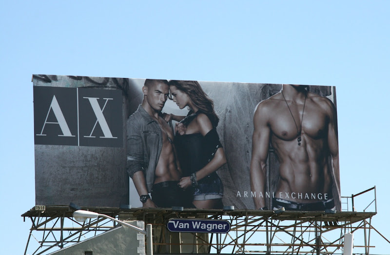 Armani Exchange male torso billboard
