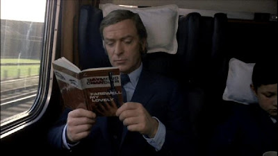 Michael Caine as Jack Carter, reads farewell my lovely in the train, Get Carter (1971), Directed by Mike Hodges