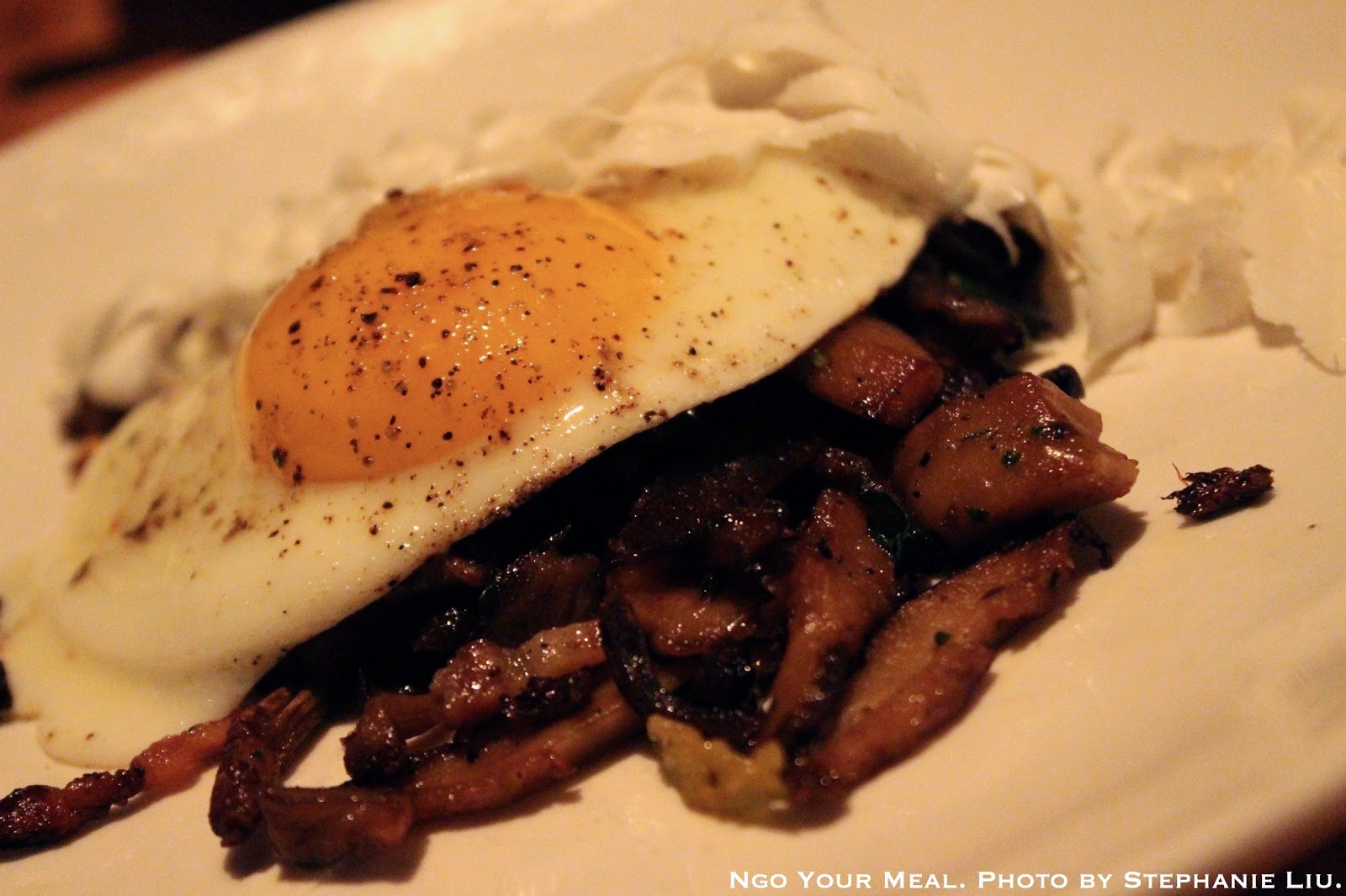 roasted mushrooms with pancetta and ricotta salata with a fried egg on top