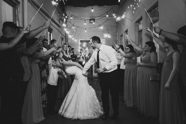 bride and groom sparkler sendoff-kissing child