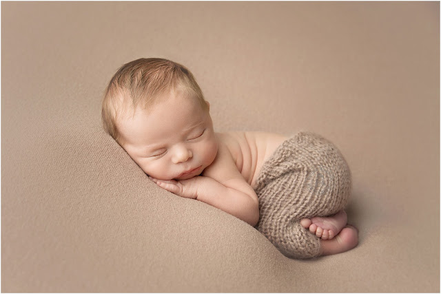 Sleeping baby on a brown background