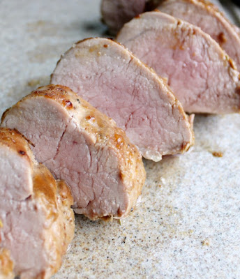 slices of pork tenderloin with blush of pink showing
