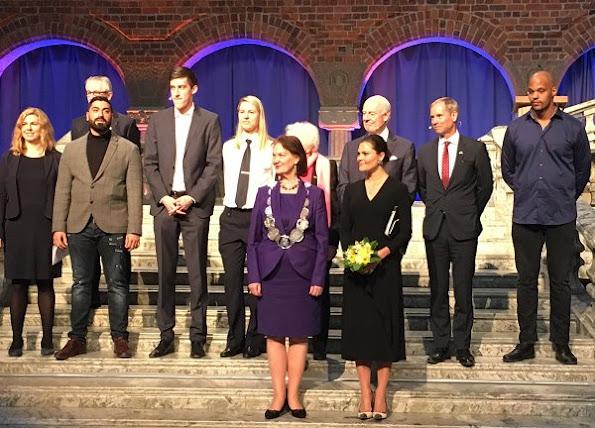 Crown Princess Victoria at 2017 Stockholm Peace Talks. Crown Princess Victoria wore Dagmar Classic Ruffle V-Neck Black Dress
