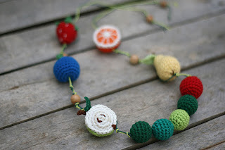 The very hungry caterpillar crochet teething baby wearing necklace