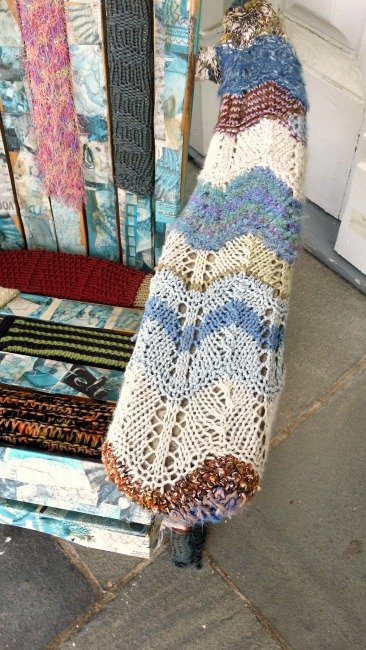 Adirondack chair wrapped in yarn and sweaters
