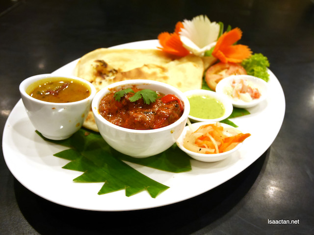 Kingly Kaadai Panner Masala (Cottage Cheese) served with condiments