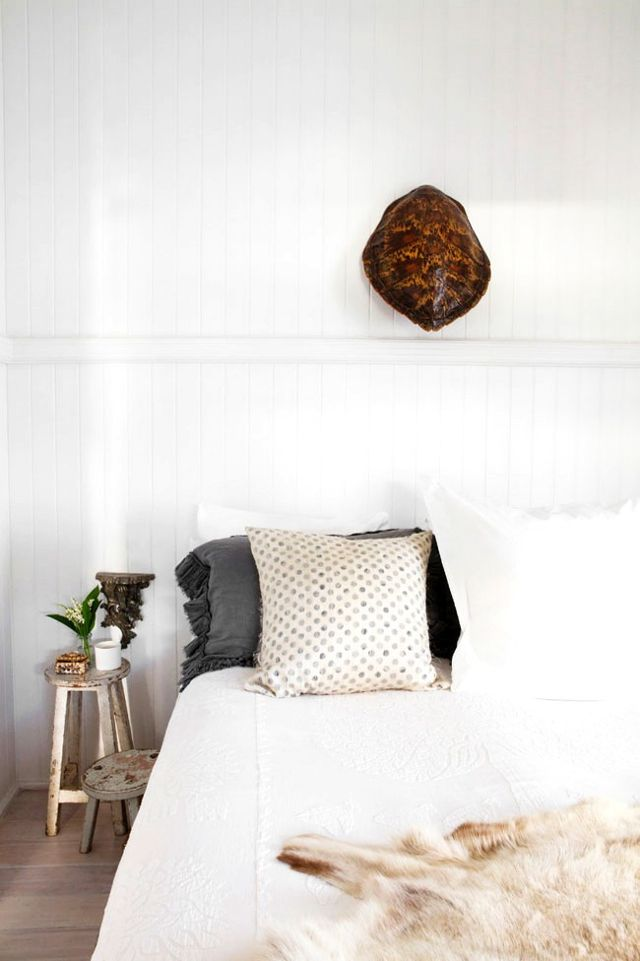 Rustic Bohemian Interior Design in a Vintage Cottage bedroom with turtle shell on white wall. #bedroom #whitebedroom #cottagestyle #rusticdecor