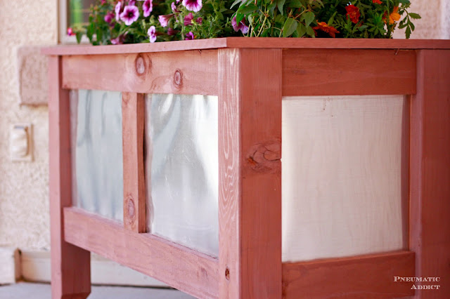 Ana white outdoor wood and metal planter box featuring pnuematic the metal accent with the redwood is so beautiful i have been thinking a lot about curb appeal lately with summer company coming anything to distract from workwithnaturefo