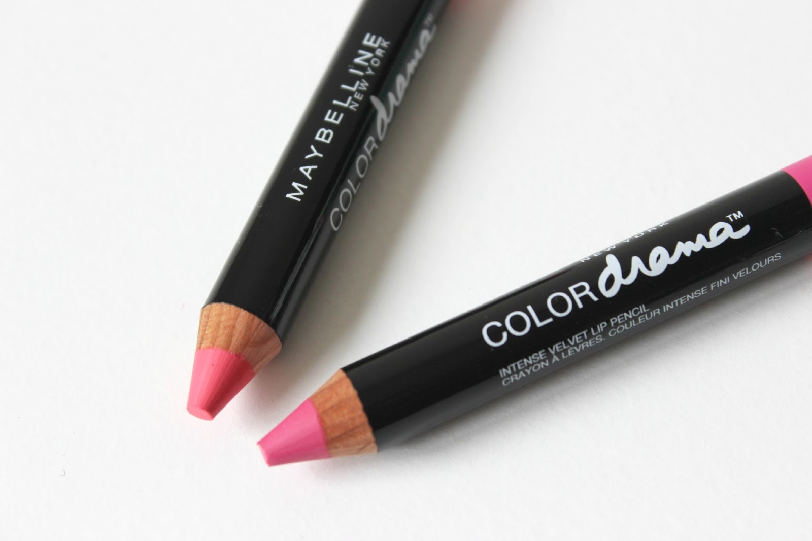 A picture of Maybelline Color Drama Intense Velvet Lip Pencil in In With Coral and Fuchsia Desire