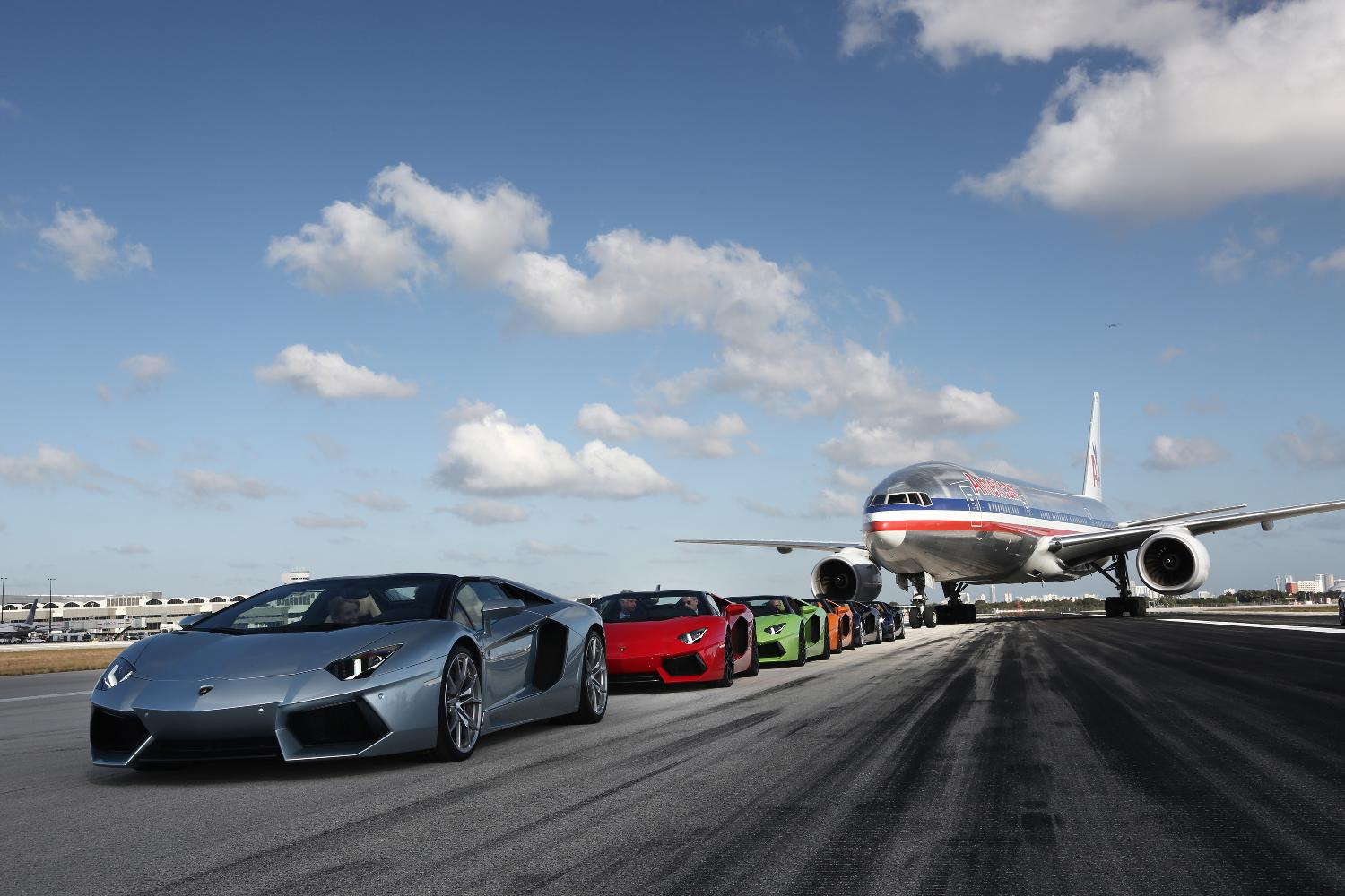 boeing 777 of american airlines and lamborghini aventador on runway